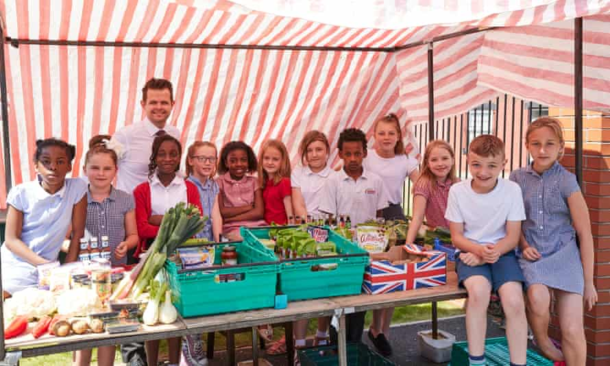Pupils from Richmond Hill Primary School, Leeds, with their headmaster Nathan Atkinson.