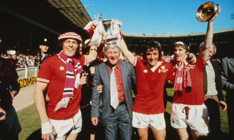 Stuart Pearson, Tommy Docherty, Lou Macari and Gordon Hill parade the FA Cup after their 2-1 win against Liverpool at Wembley in 1977