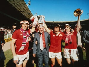 Docherty with the FA Cup after winning the 1977 final against Liverpool.