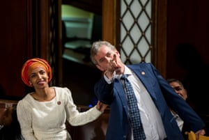 Freshman Rep. Ilhan Omar, D-Minn., and Rep. Matt Cartwright, D-Pa., look up to the gallery in the House chamber before the start of the election of the Speaker of the House.