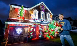 Paul Fenning outside his home covered in Christmas lights in Doncaster