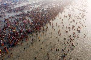 Sagar Island, India: Hindus take a holy dip in the Bay of Bengal during the Gangasagar mela
