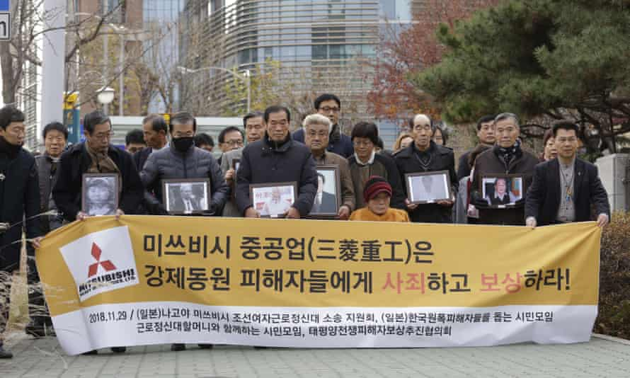 Compensated … Victims of Japan's forced labour and their family members at the supreme court in Seoul.