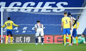 West Bromwich Albion's goalkeeper Sam Johnston (right) watches as the ball from Brighton's Danny Welbeck's penalty shot hits the post.