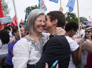 Rea Carey, right, kisses her wife, Margaret Conway, after the court ruling is announced