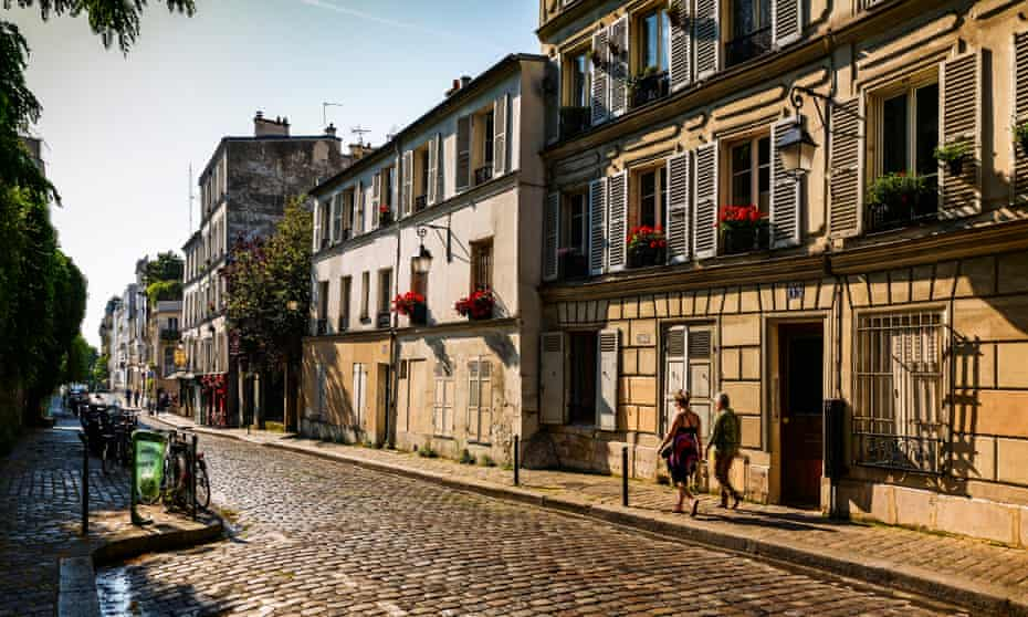 Yellow stone terraces with shuttered windows in Rue Gabrielle Street, Montmartre