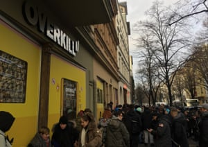 Shoppers queue outside Overkill in Berlin to get their hands on the limited edition trainers.