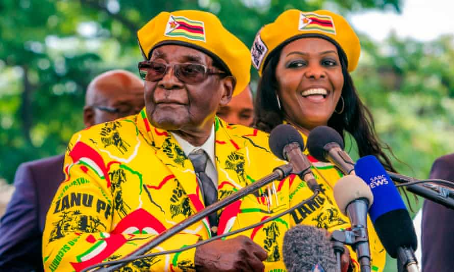 President Robert Mugabe addressing party members with his wife, Grace.
