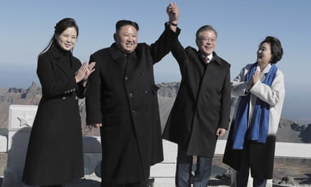 Kim Jong-un and Moon Jae-in with their respective wives at the summit of Mount Paektu
