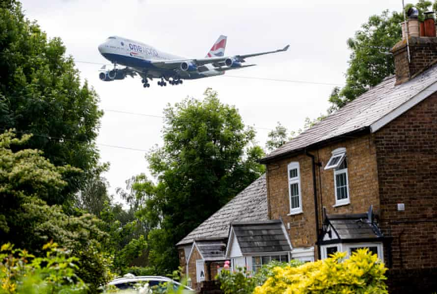 A plane prepares to land at Heathrow, viewed from the village of Longford.