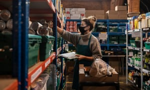 A member of staff prepares food bank parcels St Margaret's church in Streatham Hill, south London