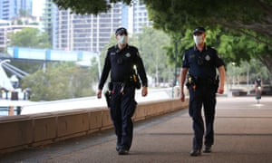 Police officers patrol the Southbank precinct during greater Brisbane's three-day lockdown