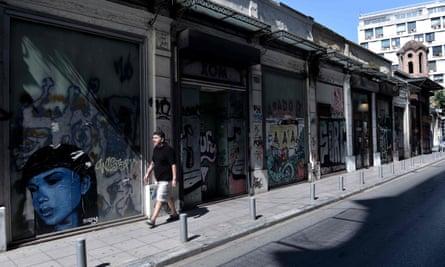 A man walks past closed shops in Thessaloniki.