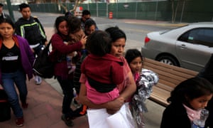 Central American migrants, who were dropped off at a bus station by Ice, walk toward volunteers helping them with food and transportation to emergency shelters in El Paso, Texas, on Christmas Day.