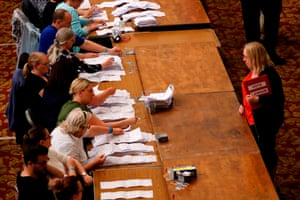 A Labour party candidate observes a count for South East England at Southampton's civic centre