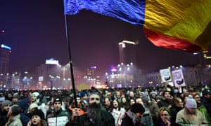 People demonstrate in the Romanian capital against the ordinance.