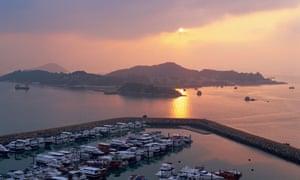 Sunset over island and marina