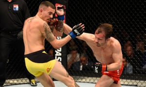 Brad Pickett of England punches Marlon Vera of Ecuador in their bout at the O2.