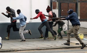 Pretoria, South Africa A metro police officer fires rubber bullets