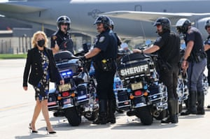 Wisconsin, USFirst Lady Jill Biden walks past a local motorcycle police escort before boarding a plane in Milwaukee. She attended a listening session with teachers and parents to discuss the return of in-person learning.