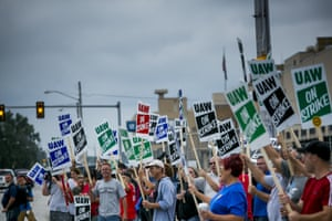 Demonstrators protest during a United Auto Workers strike outside the General Motors' Flint Assembly plant in Flint, Michigan.
