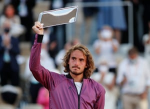 Stefanos Tsitsipas poses with the runners up trophy.