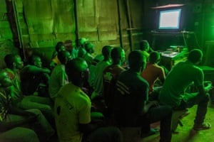 In the cinema hall he rents, a long shed with paperboard and wooden walls, Video Jockey Emmie comments live in Luganda, a local language widely spoken in Uganda, on a movie for the audience