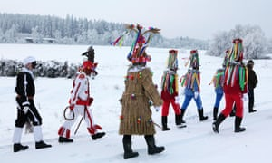 People attend the Masopust Carnival, a ceremonial Shrovetide door-to-door procession, in Vitanov near Pardubice, Czech Republic.