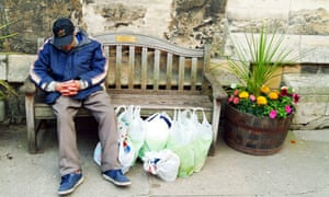 Homeless person sitting on a bench in York