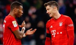 David Alaba and Robert Lewandowski in conversation during Bayern Munich's below-par 3-2 victory over Paderborn.