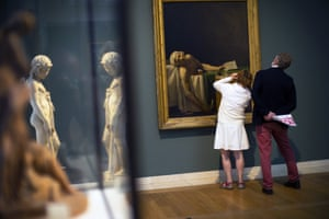 Visitors inspect The Death of Marat by Jacques-Louis David in the Royal Museum of Fine Arts in Brussels, Belgium