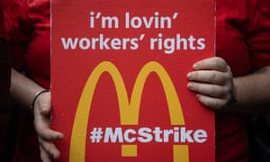 McDonald's workers stage a protest outside Downing Street in London.
