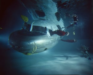 An underwater evacuation drill is performed with a sunken plane at the Civil Aeromedical Institute in Oklahoma City, 1966