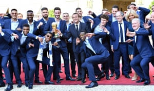 Coach Didier Deschamps and players with the president, Emmanuel Macron, arriving at the Élysée Palace