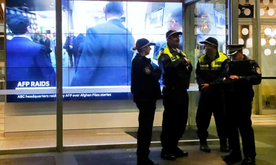 Police stand in front of the ABC building in Sydney on 5 June after officers raided the organisations over stories published in 2017.
