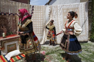 Dori Ropero, left, Angela Moreno and other women display their traditional costumes