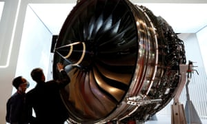 A man looks at Rolls Royce's Trent Engine displayed at the Singapore Airshow in Singapore February 11, 2020.