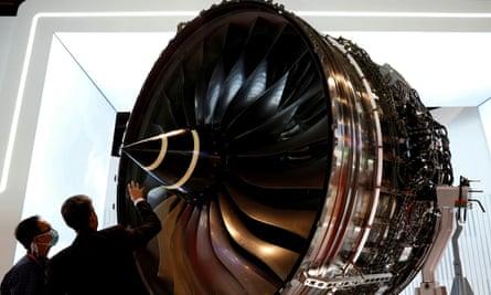 Men look at Rolls Royce's Trent Engine