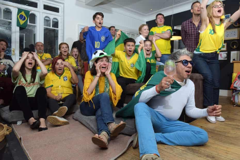 Brazil football fan Kiki Machado (in hat) with friends in Crouch End, London, 17 June 2018