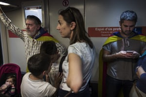 Pro-independence demonstrators take the subway to join the massive crowd
