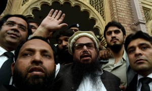 Hafiz Saeed, center, was released before dawn on Friday.