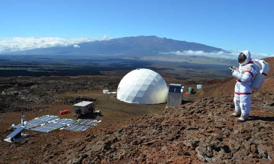 Kate Greene in her spacesuit on the volcano of Mauna Loa, with the geodesic dome she called home in the background.