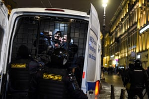 Men are detained in a police vehicle during a protest against a court ruling which ordered Russian opposition leader Alexei Navalny to jail for nearly three years in downtown St Petersburg.