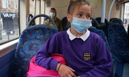 A school pupil wears a face mask