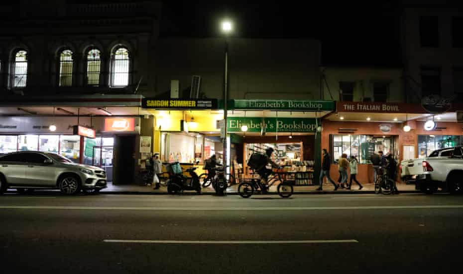 Food delivery bike riders line the streets of Newtown waiting to collect food from restaurants