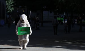 A student dressed as a bear takes to the streets, in Manchester.