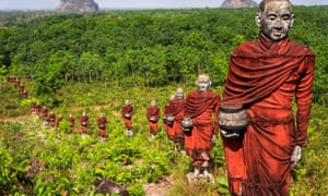Hundreds of statues of monks collecting alms surround the massive Win Sein Taw Ya Buddha in Mawlamyine.