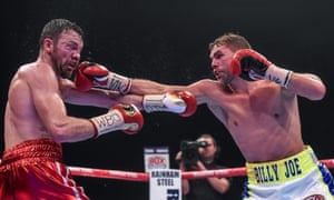 Billy Joe Saunders aims a punch at the defending champion Andy Lee during their WBO World Middleweight title fight