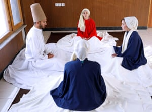 Kabul, AfghanistanFahima Mirzaie, 23, founder of a Sama Dance group meditates with her colleagues before a performance.