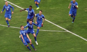 Nicolo Barella is chased by his teammates after scoring for Italy.